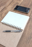 Open a blank notebook , pen and mobile phone Royalty Free Stock Photography