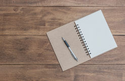 Open a blank notebook and pen stock photo