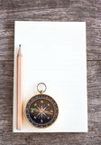 Open blank notebook pencil and compass over a wooden background Stock Image