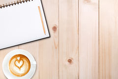 An open blank notebook with pencil and a cup of coffee on wooden Royalty Free Stock Images