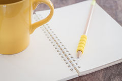 Open blank notebook with pencil Stock Photo