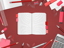Open blank notebook with school supplies Stock Images
