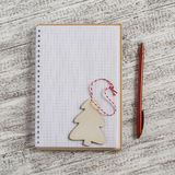 Open a blank notebook and wooden Christmas decoration - Christmas tree Royalty Free Stock Photo