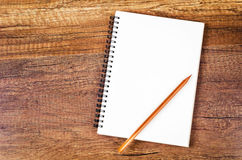 Open blank notebook with wooden pencil. Royalty Free Stock Images