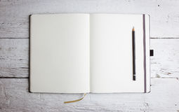 Open blank notepad with empty pages with a pencil Royalty Free Stock Images