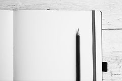 Open blank notepad with empty pages with a pencil. On white wooden table stock images