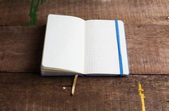 Open blank notepad with empty white pages. Laying on a wooden table Stock Photos