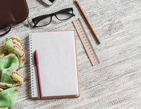 Open a blank Notepad, pen, glasses, phone, handbag and scarf Stock Photo