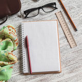 Open a blank Notepad, pen, glasses, phone, handbag and scarf Stock Images