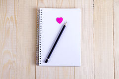 Open a blank Notepad and a pink heart Stock Photo