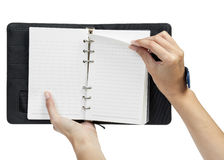 Open blank page note book and hand Royalty Free Stock Photography