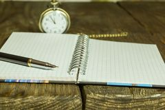Open Blank Page notebook and pen on a rustic wooden desk. A textured background. Copy paste place Stock Photography