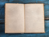 open blank pages of old book on wood background Royalty Free Stock Image