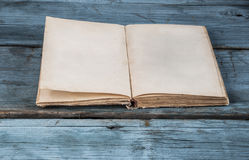 open blank pages of old book on wood background Royalty Free Stock Photography