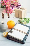 Open blank planner with lit candles Stock Photos