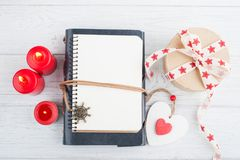 Open blank planner, with lit candles and red heart Royalty Free Stock Photos