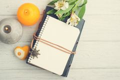 Open blank planner, top view with lit candles Stock Images