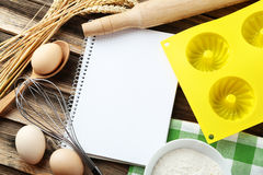 Open blank recipe book on brown wooden background Stock Image