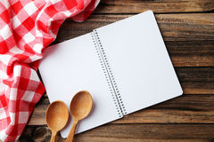 Open blank recipe book on the brown wooden background Royalty Free Stock Image
