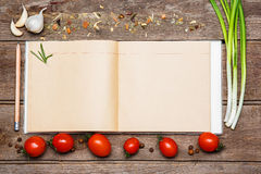 Open blank recipe book on brown wooden background Royalty Free Stock Photo