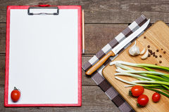 Open blank recipe book on brown wooden background Stock Photo