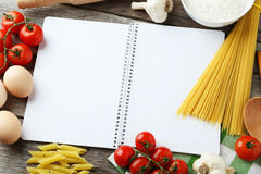 Open blank recipe book on grey wooden background Royalty Free Stock Photos