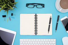 Open blank spiral notebook with office supplies Royalty Free Stock Photos