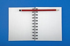 Open blank of spiral notebook with pen Stock Photo