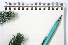 Open blank spiral notepad with metal pen christmas concept Fir t Royalty Free Stock Photo