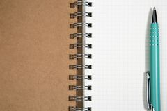 Open blank spiral notepad with metal pen christmas concept Fir t Stock Image