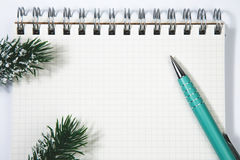 Open blank spiral notepad with metal pen christmas concept Fir t. Open blank spiral notepad with metal pen, christmas concept Fir tree branch Royalty Free Stock Photos