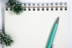 Open blank spiral notepad with metal pen christmas concept Fir t. Open blank spiral notepad with metal pen, christmas concept Fir tree branch Stock Images