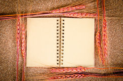 Open blank vintage diary with wheat. Royalty Free Stock Image