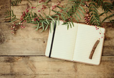 Open blank vintage notebook and wooden pencil over wooden table. ready for mockup. retro filtered image Stock Photography