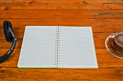 Open a blank white notebook and cup of coffee Stock Photo