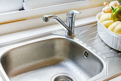 Kitchen faucet with a flowing water Stock Photo