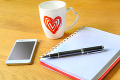 Open a blank white notebook and cup of coffee Stock Photography