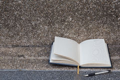Open a blank white notebook, pe Stock Photography