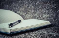 Open a blank white notebook, pen Stock Photography