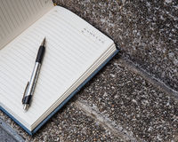 Open a blank white notebook, pen Royalty Free Stock Image