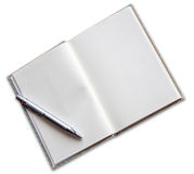 Open a blank white notebook and pen on white background Royalty Free Stock Photography