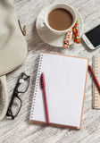 Open a blank white notebook, pen, women's bag, phone, ruler, pencil and cup of coffee Stock Photo