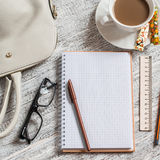 Open a blank white notebook, pen, women's bag, ruler, pencil and cup of coffee Royalty Free Stock Image