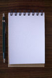 Open a blank white notebook with pencil Stock Images
