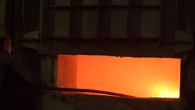 Open blast furnace at a steel factory. In the furnace, a huge temperature, the metal melted, the workers follow the. Technological process. Heavy industry stock footage