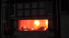 Open blast furnace at a steel factory. In the furnace, a huge temperature, the metal melted, the workers follow the. Technological process. Heavy industry stock video footage