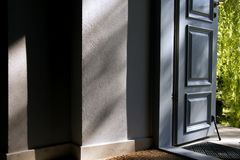 Open blue door into the house. Royalty Free Stock Photo
