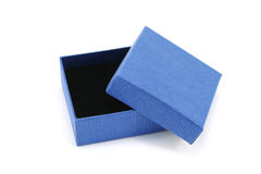Open Blue Gift Box. Open blue cardboard box with black foam interior as used for small jewellery pieces Stock Photo