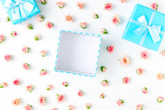 Open blue gift box with pink roses on white background Royalty Free Stock Photos