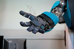 Open blue robot hand closeup Royalty Free Stock Photo